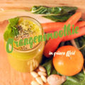 Orangensmoothie im grünen Kleid